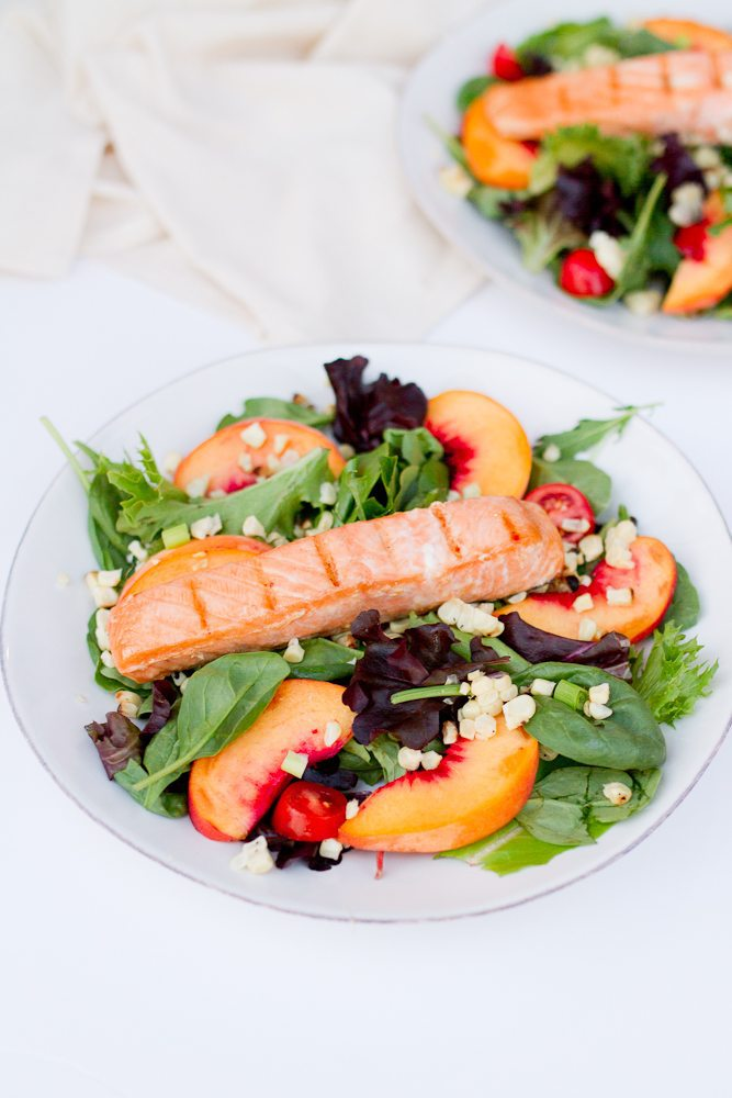 Grilled Salmon Summer Salad -- The ultimate summer salad with lightly marinated grilled salmon, sliced peaches, tomatoes and grilled sweet corn. The flavors come together to make a fresh and flavorful entree sized salad.