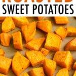 Roasted sweet potato chunks on a sheet pan.