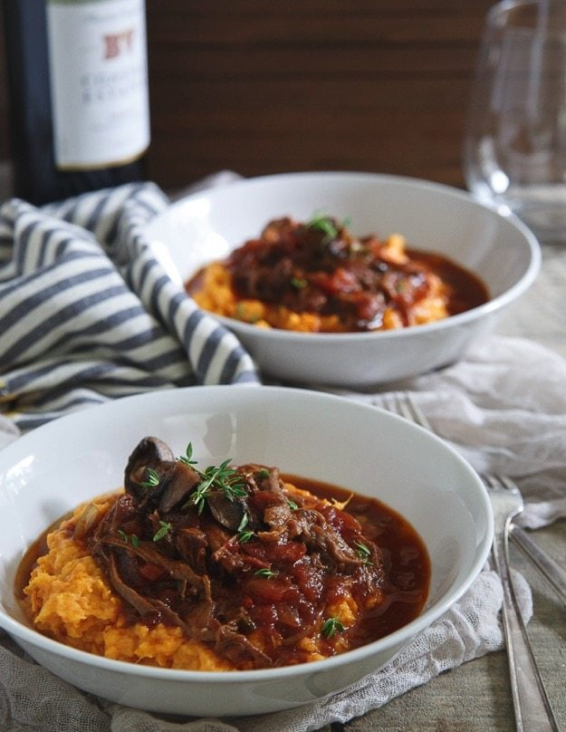 Two shallow, white bowls of Slow Cooker Short Rib Ragu.