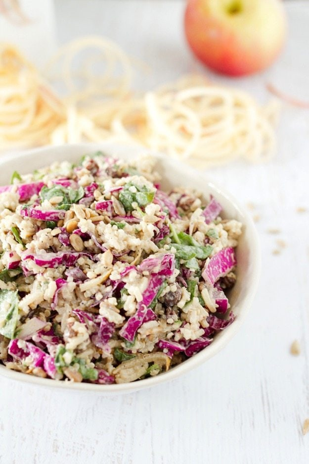 This slaw recipe combines spiralized apples, cabbage, baby spinach and quinoa for a healthy and innovative twist on traditional coleslaw. The dressing is mayo-free and instead has a base of tahini and apple cider vinegar.