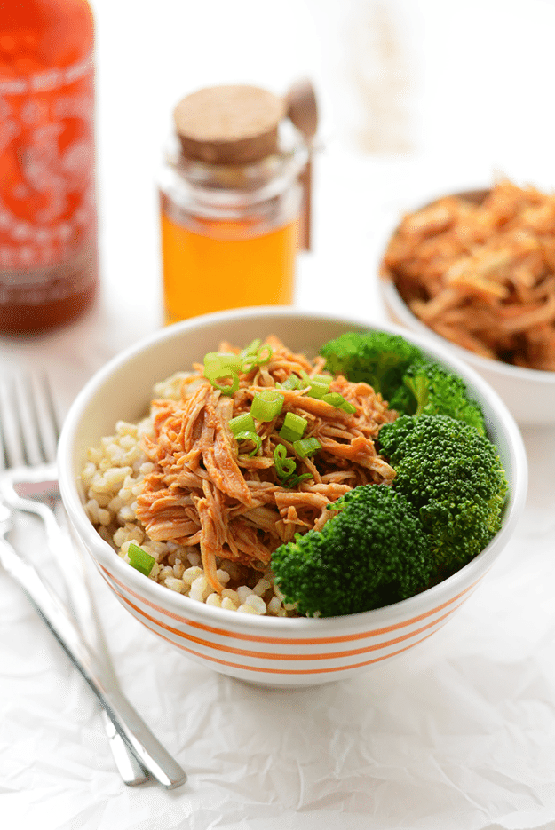 Honey Sriracha Chicken in a bowl with broccoli and rice.