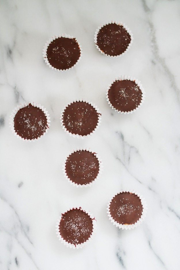 Overhead shot of Homemade Peanut Butter Cups on a marble countertop.