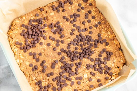 Pumpkin protein bars baked in a ceramic dish.