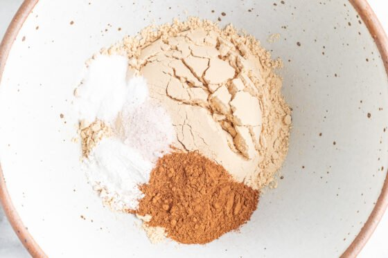Dry ingredients for pumpkin protein bars in a bowl.