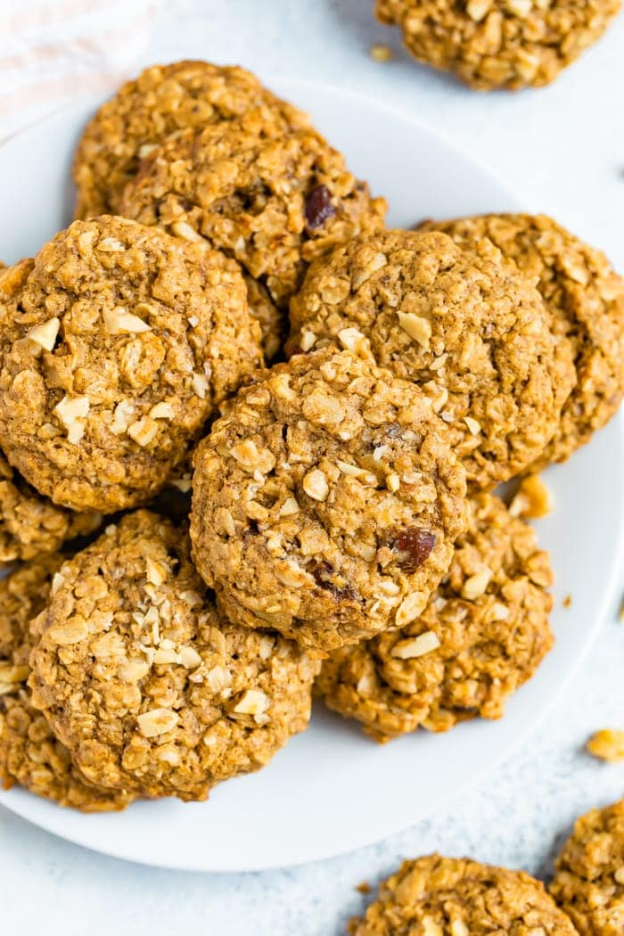 Oatmeal date cookies on a white plate.