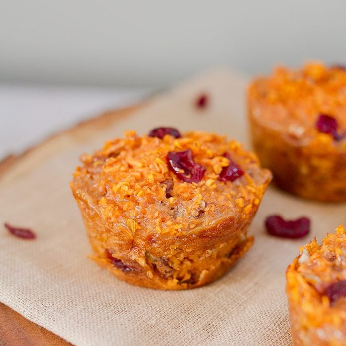 Spiralized cranberry pecan sweet potato muffins made with riced sweet potato noodles. They're moist, filling and delicious served warm straight from the oven or at room temperature.