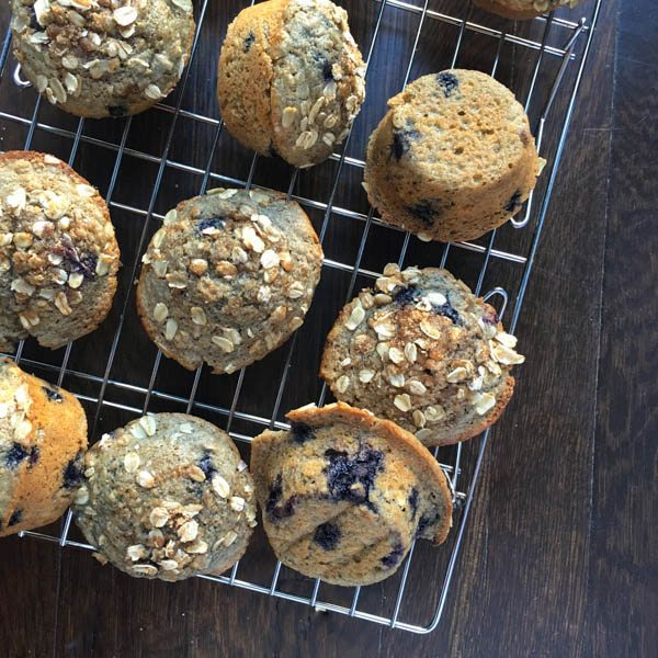 Blueberry Oatmeal Yogurt Muffins on a cooling rack.