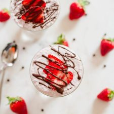 Chocolate Covered Strawberry Chia Pudding with creamy coconut milk, strawberries and a chocolate drizzle.