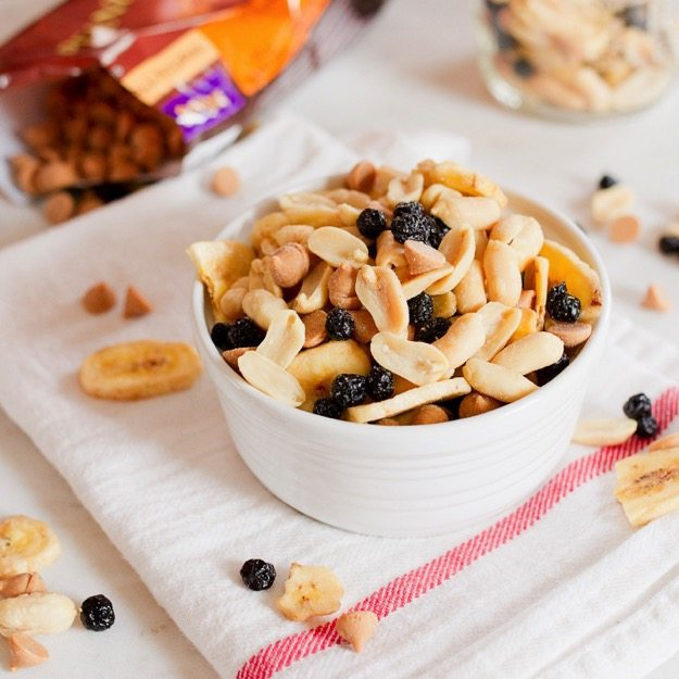 Sweet and salty trail mix with a blend of crunchy peanuts, dried blueberries, peanut butter chips and dried bananas.