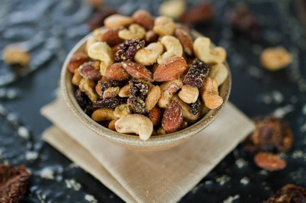 A savory mix of roasted nuts with sun-dried tomatoes and Italian seasonings, this Pizza Trail Mix is the ultimate snack.