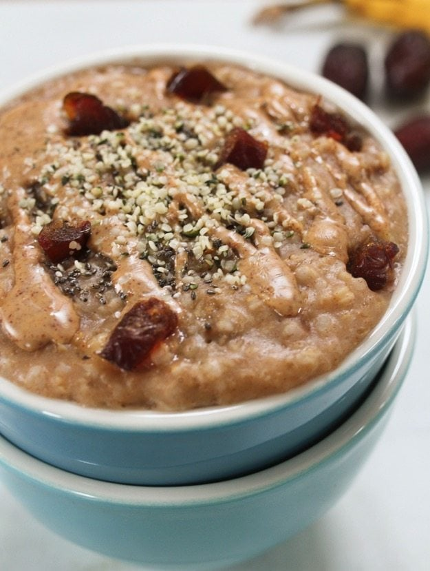 Close up shot of Salted Date Steel-Cut Oatmeal in a blue bowl.