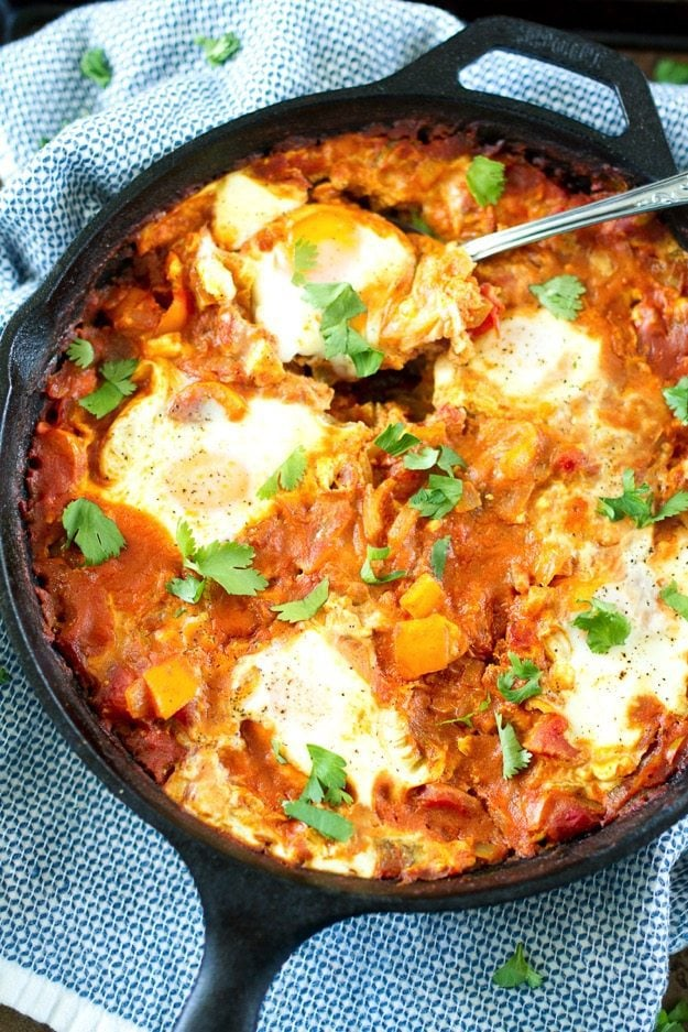 Curried Shakshuka -- a healthy one-pan dish with poached eggs in a flavorful tomato sauce, comes together quickly and can be served any time of the day!