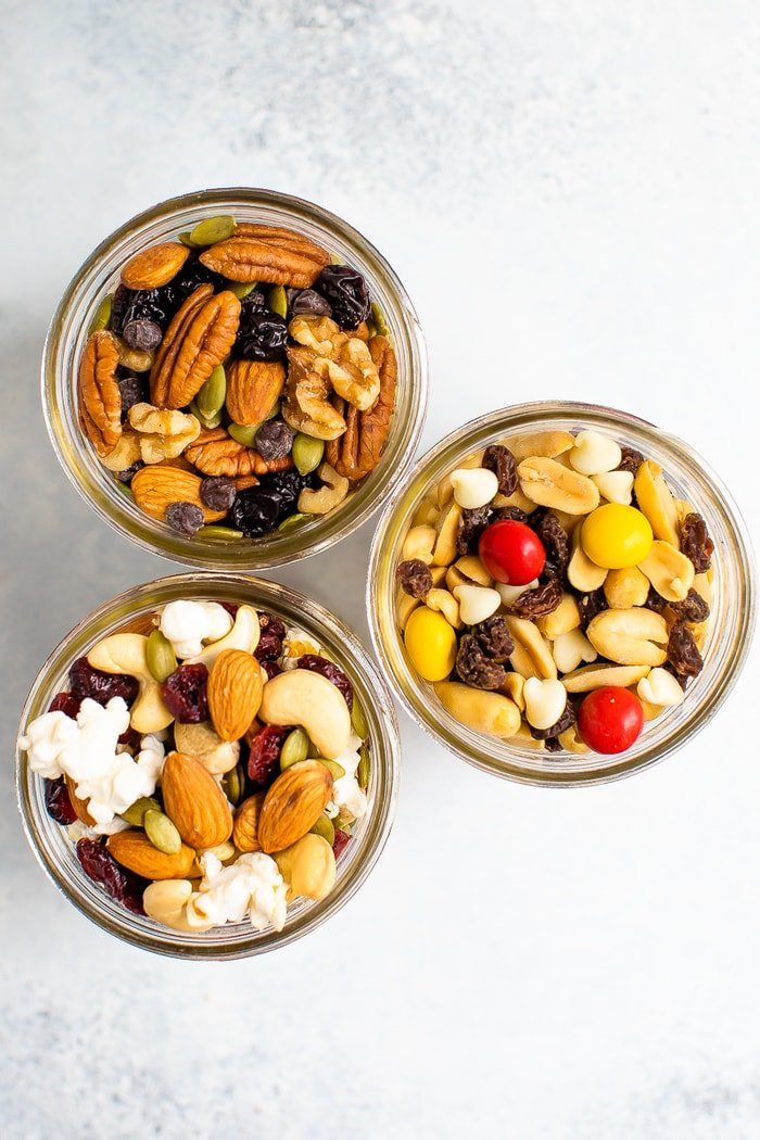 Three mason jars of different trail mixes.