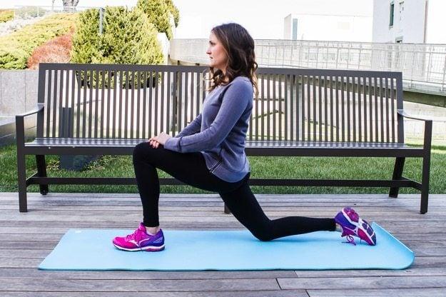 Girl on yoga mat doing a hip stretch.