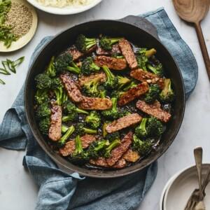 Teriyaki tempeh and broccoli in a skillet.