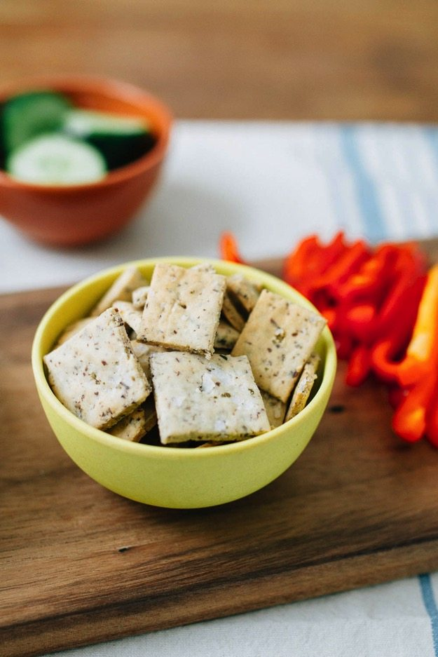 Homemade almond crackers with 3 simple ingredients -- almond flour, ground flaxseed and sea salt. Rich, buttery, crunchy, gluten-free, vegan and perfect for dipping into hummus!