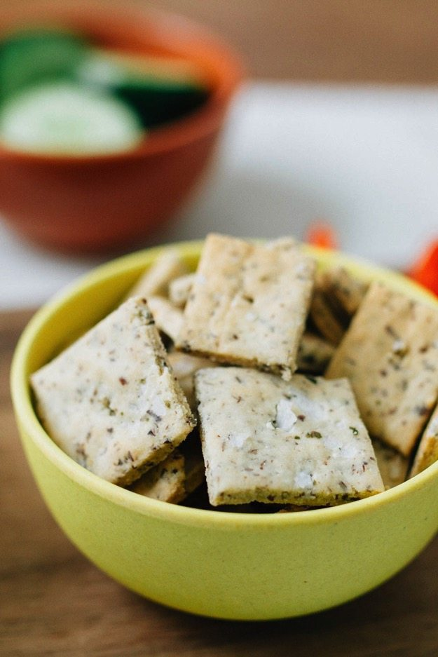 A recipe for homemade almond crackers with 3 simple ingredients -- almond flour, ground flaxseed and sea salt. Rich, buttery, crunchy, gluten-free, vegan and perfect for dipping into hummus!