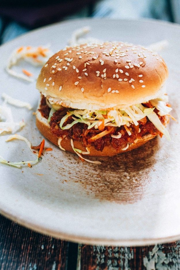 The BEST vegan BBQ sandwich made with shredded hearts of palm, homemade BBQ sauce and a crunchy apple cider vinegar coleslaw.