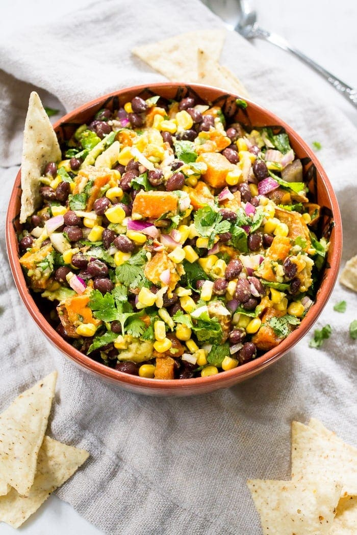 This delicious sweet potato black bean dip is loaded with flavor and perfect served with tortilla chips, as a side or as a topping for salads and tacos. #glutenfree #vegan