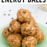 Stack of peanut butter energy balls on a plate.