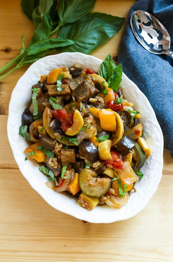 Slow Cooker Ratatouille // Load your summer farmers market haul into the slow cooker for a delicious ratatouille that you can use in a variety of ways. Serve as a side, over pasta or bread, with a grilled protein or even in an omelet.