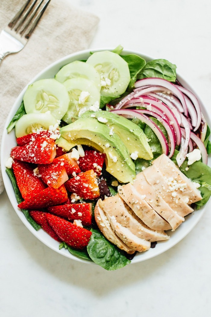 Strawberry Fields Salad grilled chicken, crunchy cucumber slices, avocado, red onion, feta and a citrus poppy seed dressing.