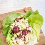 Almond butter chicken salad made with almonds, celery and grapes in lettuce cups.