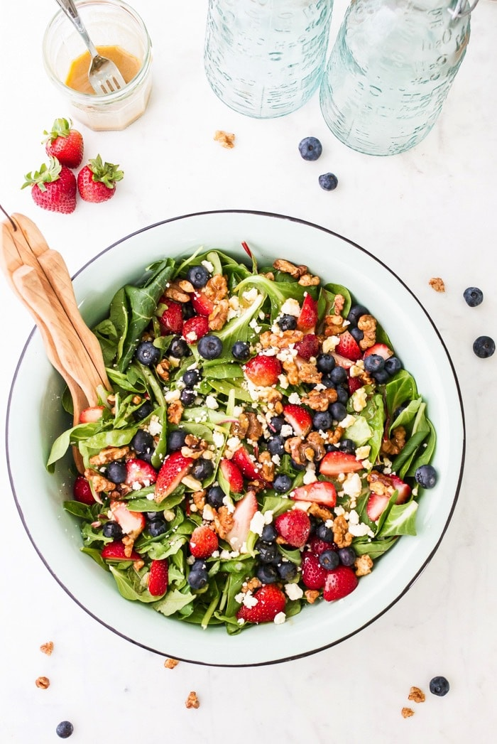Patriotic berry salad loaded with fresh berries, crunchy maple walnuts and blue cheese. The red white and blue theme makes it perfect for the 4th of July.