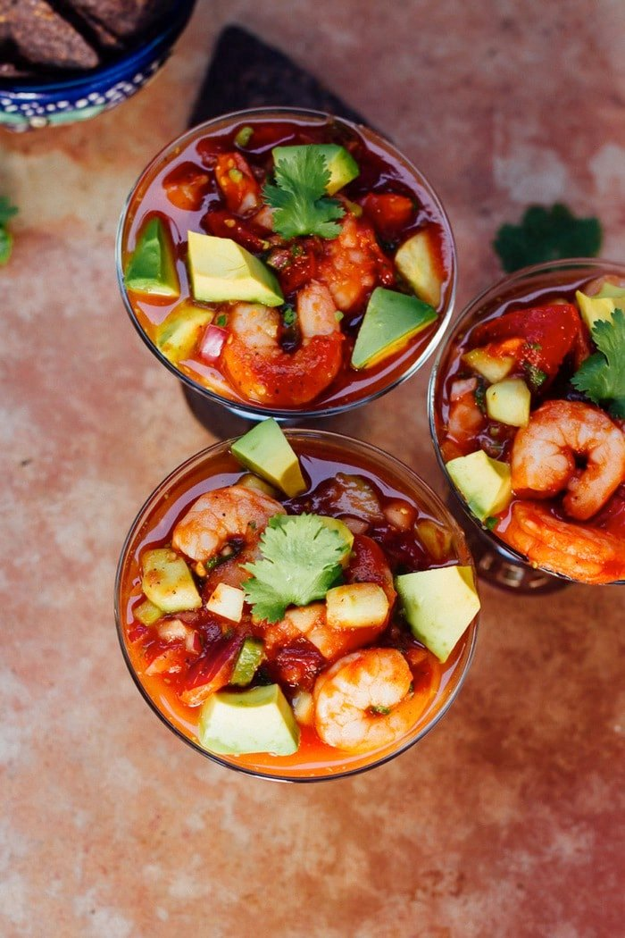 Mexican shrimp cocktail with tomatoes, cilantro and avocado served with black bean chips.