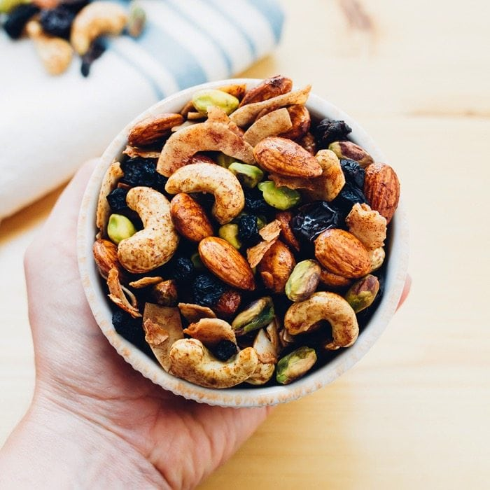 A delicious Breakfast Trail Mix with maple cinnamon roasted nuts, coconut flakes and dried berries. Perfect for eating on its own or as a topping for yogurt and oatmeal.