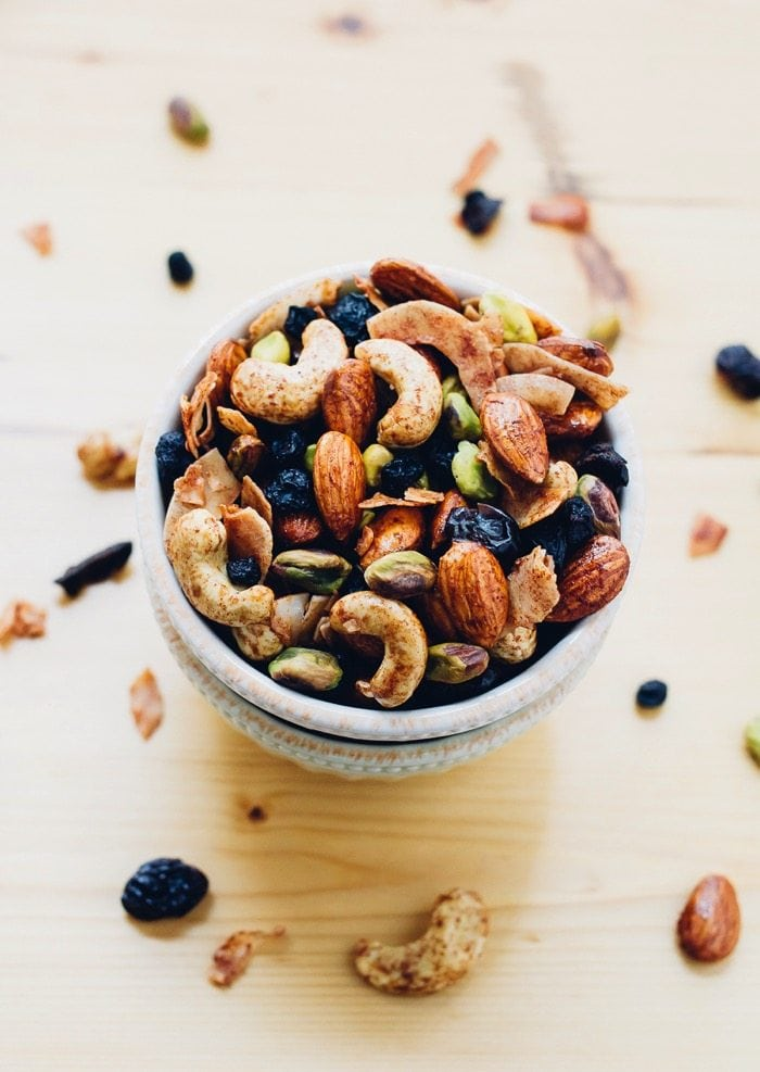 A delicious Breakfast Trail Mix with maple cinnamon roasted nuts, coconut flakes and dried berries. Perfect for eating on its own or as a topping for yogurt or oatmeal.