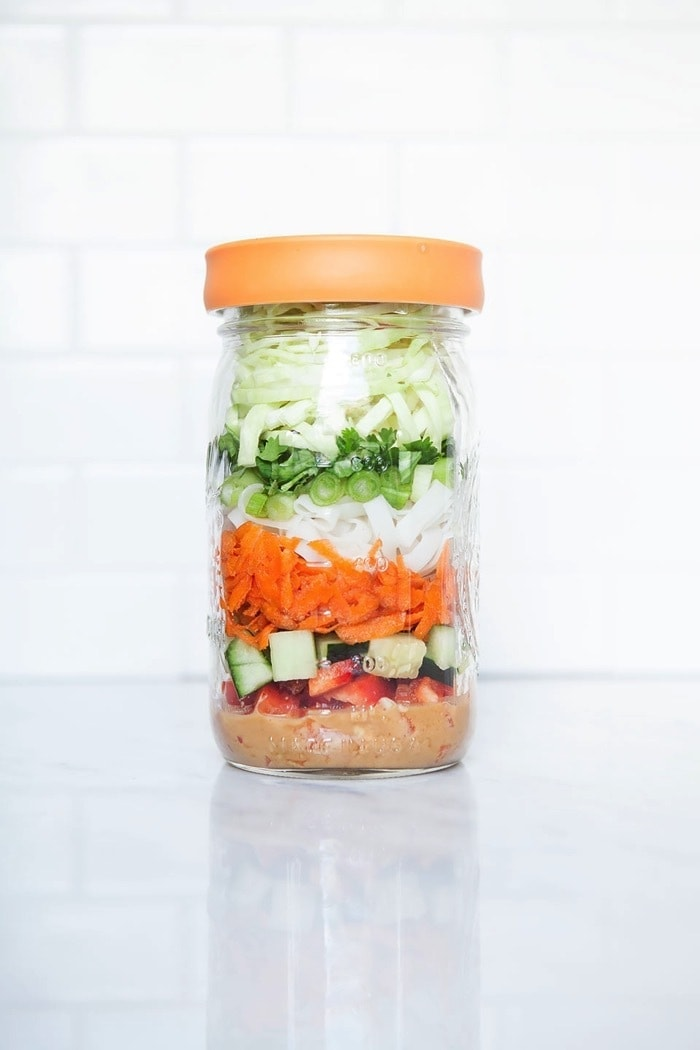This Peanut Noodle Salad in a Jar is the perfect layered salad to pack for work. It's healthy and nourishing but substantial enough to keep you from making that afternoon run to the vending machine (sayonara, Skittles!).