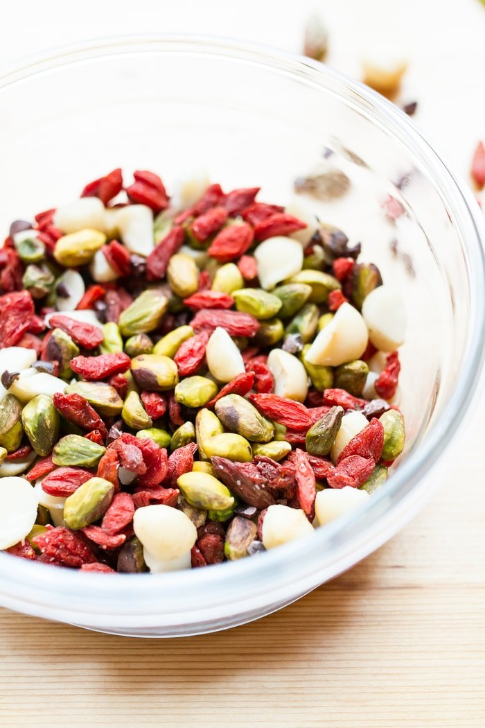 Snack healthy with this crunchy, vibrant pistachio trail mix. It's a delicious blend of roasted pistachios, macadamia nuts, goji berries and cacao nibs. Vegan, gluten-free, low sugar and low carb!