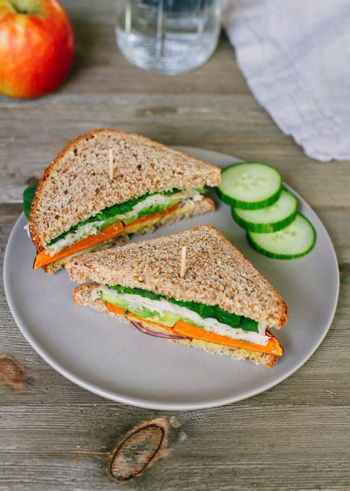 Healthy Sweet Autumn Turkey Sandwich packed with crispy apple slices, roasted sweet potato, red onion, avocado and a honey mustard hummus spread.