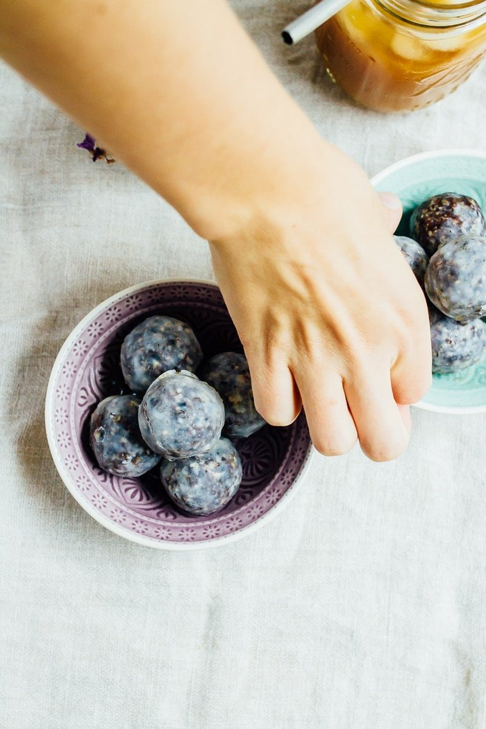 No Bake Blueberry Muffin Donut Holes with a coconut maple glaze. They're vegan, gluten-free and absolutely delicious.