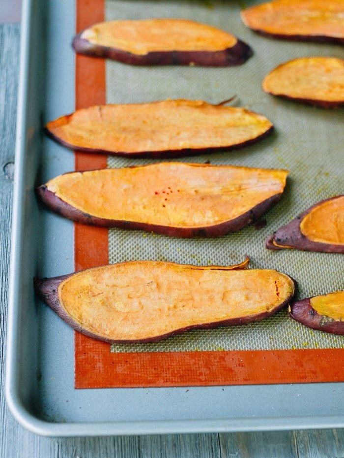 Sliced sweet potato on a baking sheet.