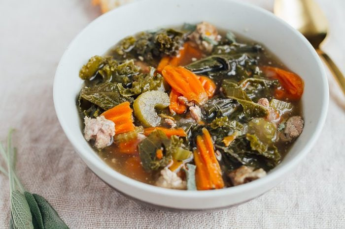 Warm up with this slow cooker sausage kale soup. Packed with flavor and veggies, this 10-ingredient soup is easy to whip up and tastes delicious!