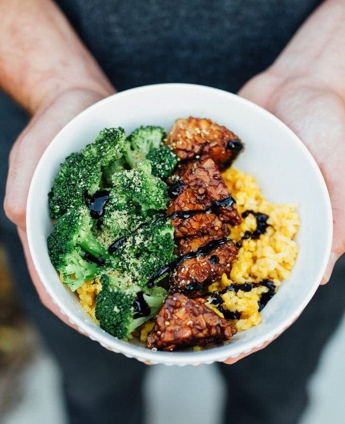 Maple Balsamic Tempeh Bowls with creamy pumpkin rice and steamed broccoli.