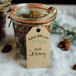Rosemary candied pecans in a jar with a tag reading, baked with love , to: mom, from: Brittany.