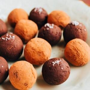 Avocado chocolate truffles on a plate.