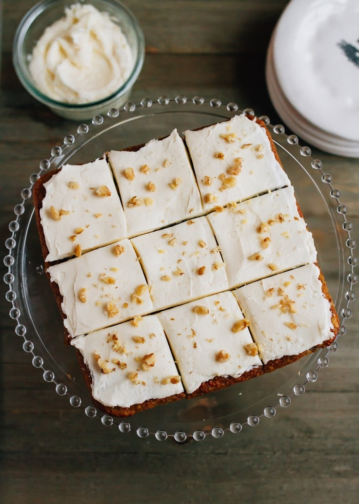 Paleo-friendly carrot cake bars made with almond flour and sweetened with coconut sugar. They're moist, delicious and perfect for the carrot cake lover in your life. Gluten-free and grain-free.