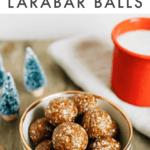 Bowl of gingerbread Larabar balls next to a mug of milk and Christmas tree decorations.