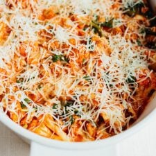 Cauliflower baked ziti topped with parmesan before its cooked.