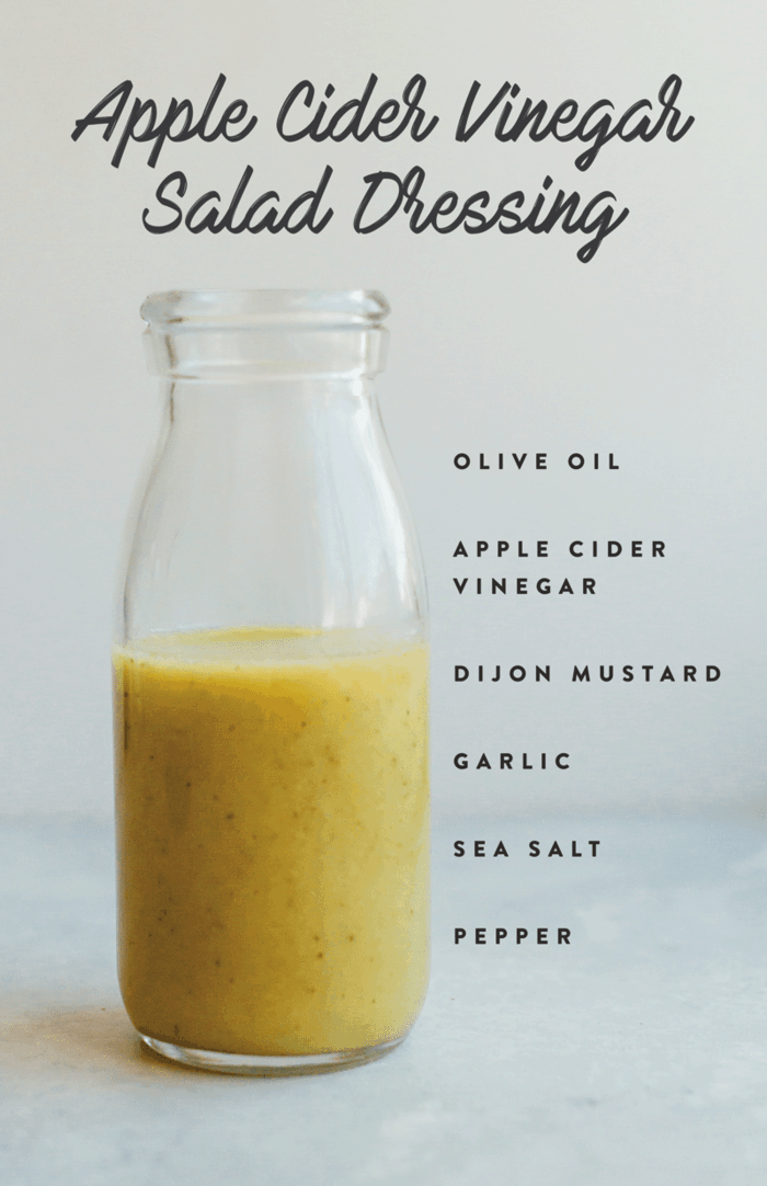 Healthy homemade apple cider vinegar salad dressing in a glass jar with ingredients listed down the side of the image.
