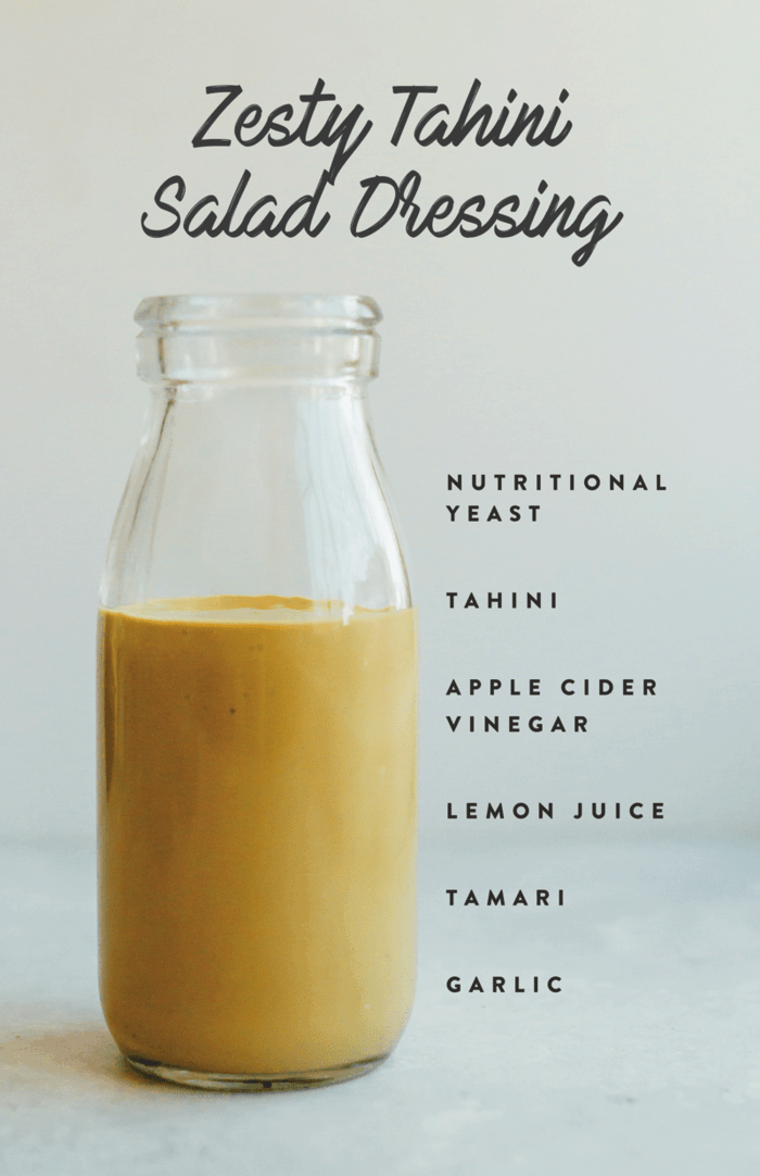 Zesty tahini salad dressing in a glass jar with ingredient text on the side.