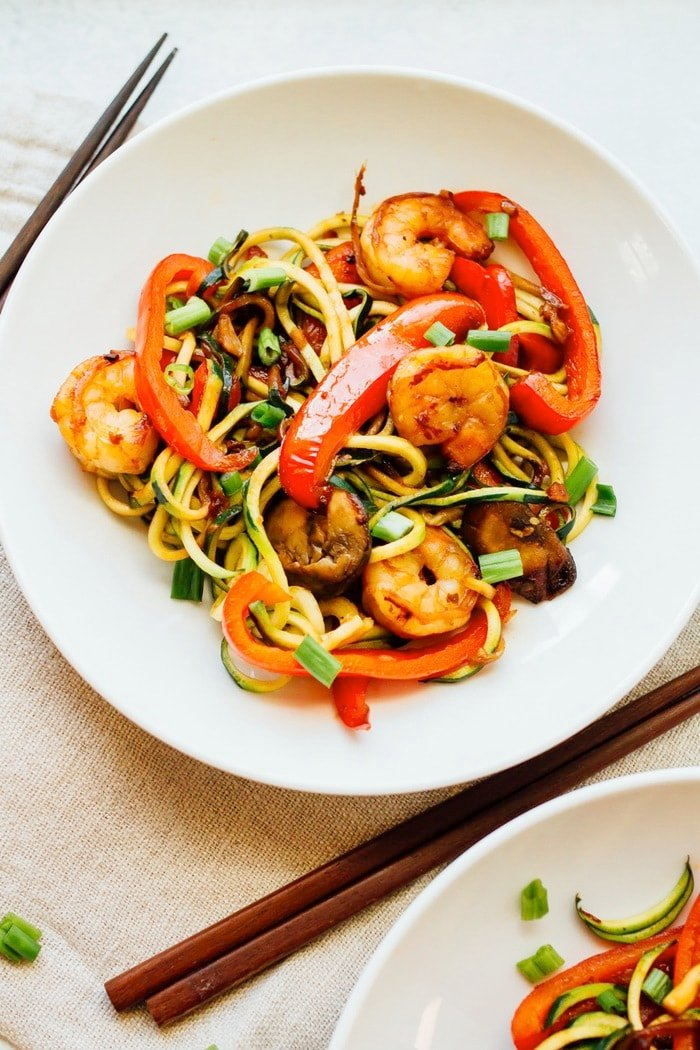 Have dinner ready in less than 20 minutes with this quick and easy zucchini noodle shrimp lo mein. It's loaded with veggies and perfect for busy weeknights. Paleo and gluten-free.