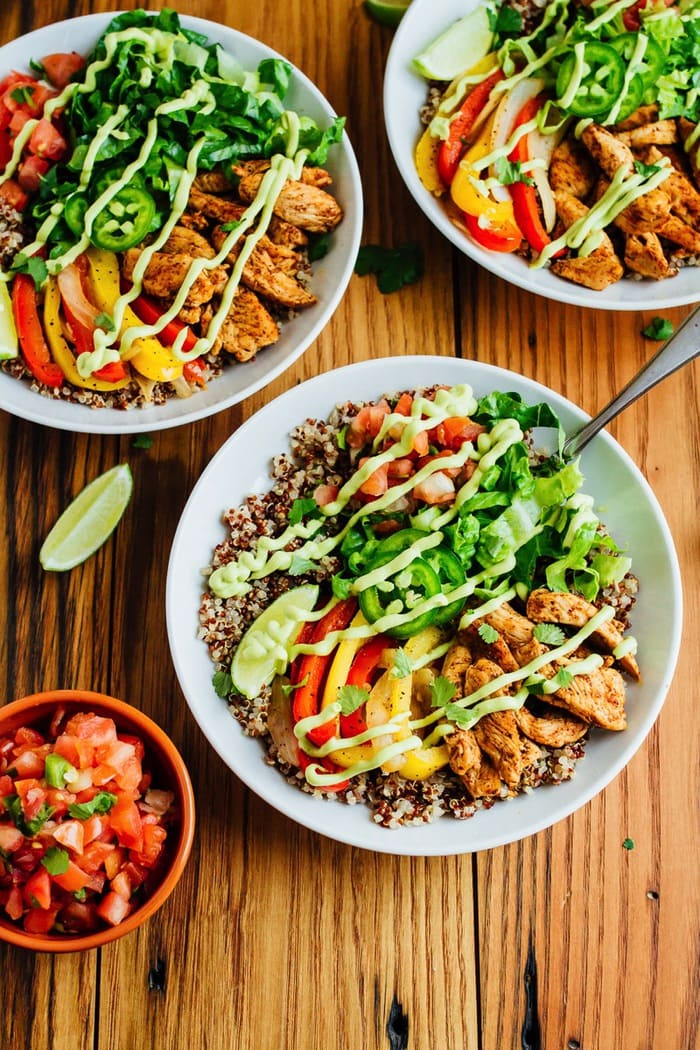 Make Mexican night fun and healthy with these chicken fajita quinoa bowls featuring spiced-up chicken, sautéed peppers and a creamy avocado goat cheese sauce.