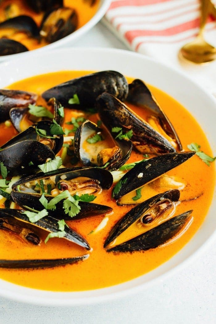 Coconut curry mussels are steamed in a red curry broth and served with zucchini noodles for a healthy, yet rich and satisfying appetizer or light meal.