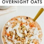 Carrot cake overnight oats topped with coconut and walnuts.