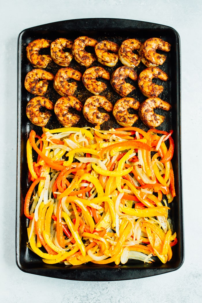 These sheet pan shrimp fajitas make for an easy weeknight meal with Mexican flavor. Simply bake your shrimp, peppers and onions together on one sheet, load up your tortillas and enjoy!